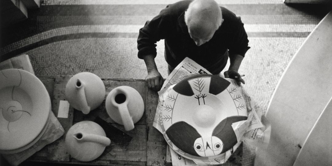"Pablo Picasso looking at the ceramic ""Owl"" near the stairwell at La Californie, Cannes by David Douglas Duncan"