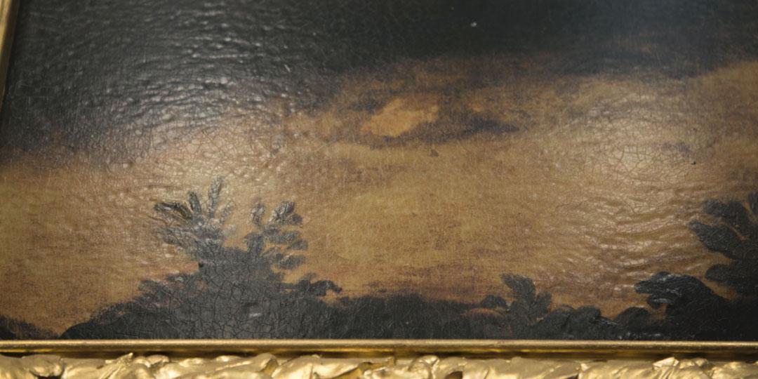 détail d'un tableau montrant la finition de craquelure et vernis